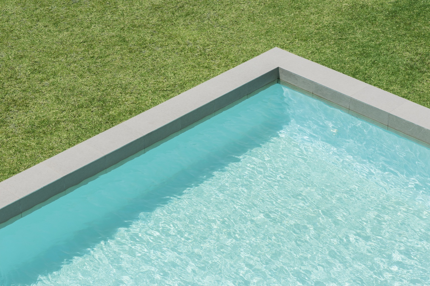 The corner of an in-ground swimming pool