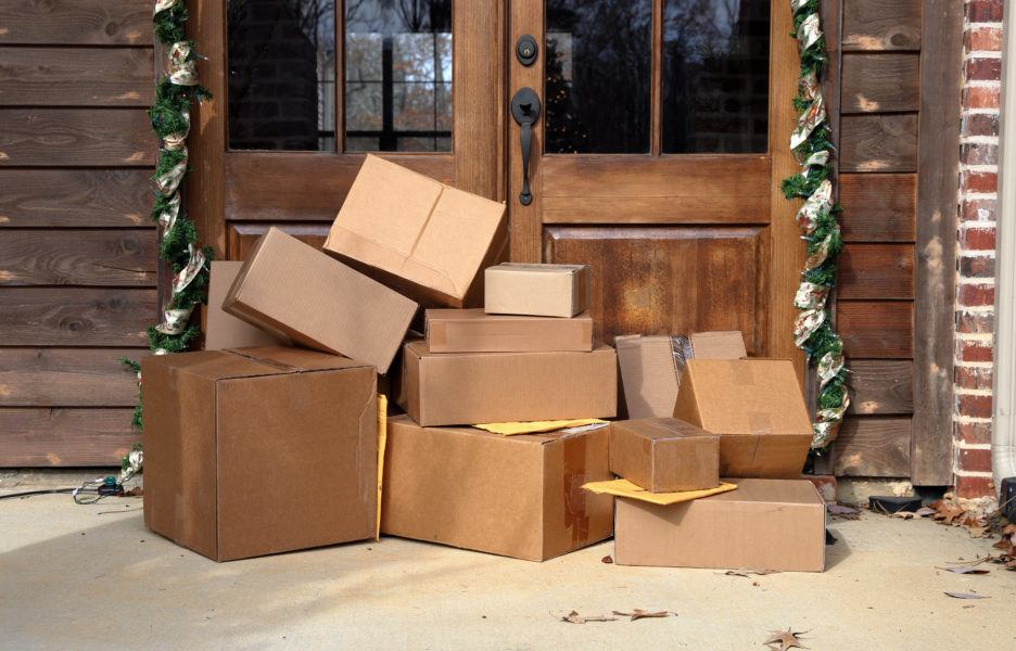 Packages begin to pile up on a front porch.
